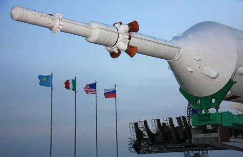 The nose of a Russian Soyuz TMA-20 is seen on the skyline