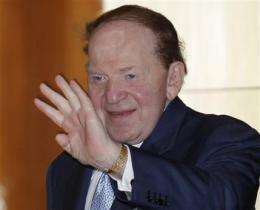 World's richest casino exec opposes online wagers (AP)