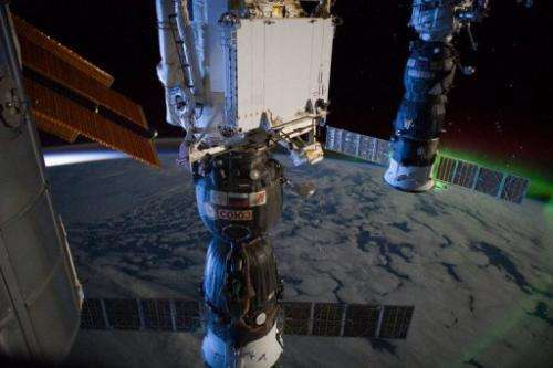 A Russian Soyuz (left) and Progress  spacecraft are docked at the  International Space Station
