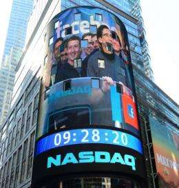 Facebook co-founder Mark Zuckerberg is seen on a screen getting ready to ring the NASDAQ stock exchange opening bell