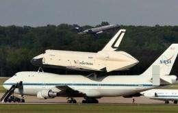 The space shuttle Enterprise sits atop a NASA 747 shuttle carrier aircraft