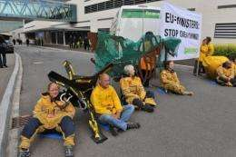 Greenpeace activists block the access to the Council building in Luxembourg Tuesday