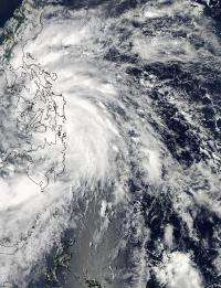 NASA satellite shows the Tropical Storm Son-tinh's reach over Philippines