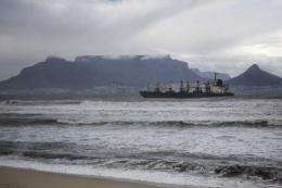 A bulk carrier sits after running aground in 2009 in front of the Table Bay beach