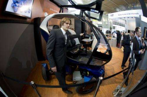 A car that retracts to fit into a smaller parking space is seen at the world's biggest high-tech fair