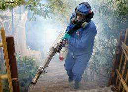 An employee spray insecticide in 2010 in La Gaude, southern France, during a mosquito eradication operation