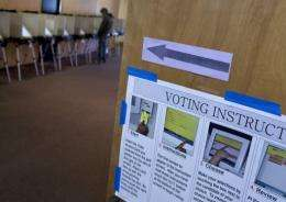 A voter casts his ballot at a voting machine