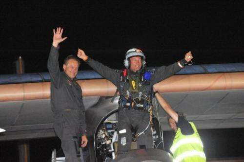 Bertrand Piccard (right) celebrates next to co-pilot Andre Borschberg after landing at Rabat Sale airport