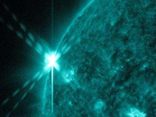 Emerging sunspot releases mid-level solar flare