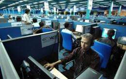 Filipino call centre personnel attending to their US clients at a business process outsourcing office in Manila