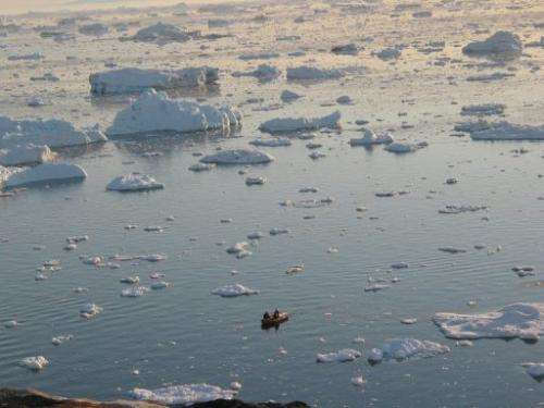 Fishermen in the Ilulissat Icefjord, western Greenland