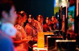 Gamers and show attendees play video games at the XBOX 360 booth during an expo in 2011 in Los Angeles, California