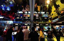 Gamers sample games on the opening day  of the E3 videogame conference in Los Angeles on June 5