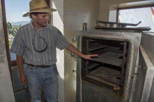German Gregor Schappers shows a bread oven heated with solar energy