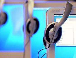 Headphones are displayed on computer screens