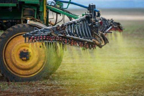 Herbicide is sprayed on a soybean field in 2011
