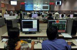 Indian scientists watch displays at The Indian Space Research Organisation's Master Control Facility in 2011