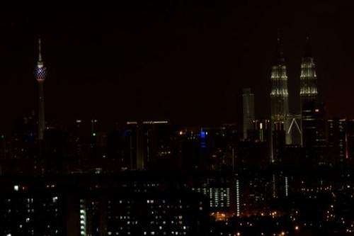 Malaysia's landmarks have their lights being switched off for Earth Hour in Kuala Lumpur