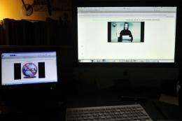 Monitors display the hacked Greek ministry of justice website