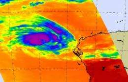 NASA sees strong thunderstorms still surround Cyclone Iggy's center