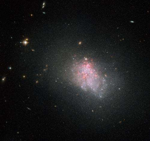 NGC 3738: hubble sees violent star formation episodes in dwarf galaxies