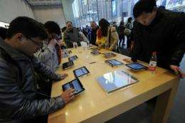 People look at Apple iPads at a store in Shanghai yesterday