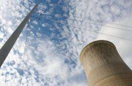 Power lines run past the cooling tower at a coal power plant in New Haven, West Virginia