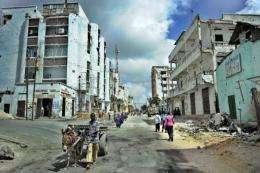 Residents walk through the Bakara market area of Somalia's embattled capital Mogadishu, in 2011