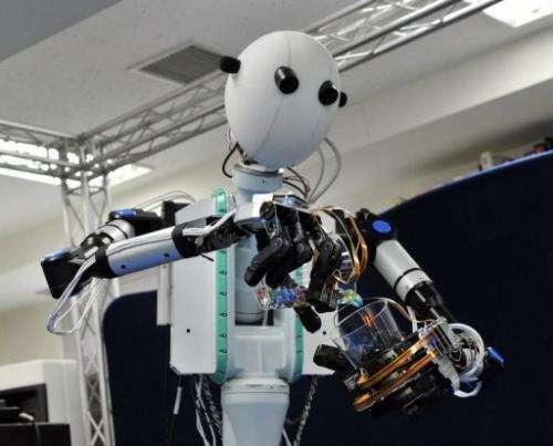 """Robot's """"eyes"""" are actually cameras capturing images that appear on tiny video screens in front of the user's eyes"""