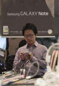 Samsung coyness puts smartphone crown in dispute (AP)