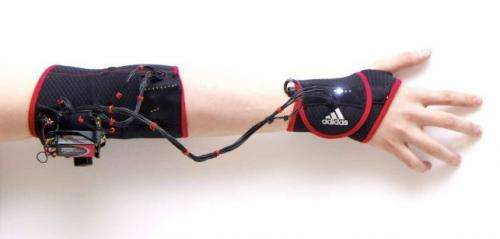 Vibrating armband helps athletes make the right moves