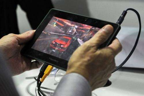 Smartphones and tablet computers are expanding the market for handheld video games and challenging traditional devices