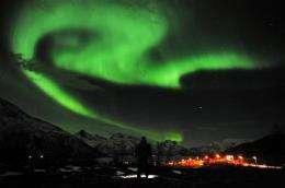 Solar storm sparks dazzling northern lights (AP)