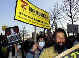 """The anti-nuclear activists urged Tokyo to """"give back our hometown. Protect our children"""""""