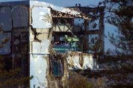 The crippled Fukushima Dai-ichi nuclear power station is seen through a bus window in Okuma in 2011