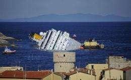 The stricken cruise liner Costa Concordia off the Isola del Giglio in January 2012