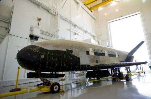 The X-37B weighs five tonnes and is 29 feet (8.9 meters) long
