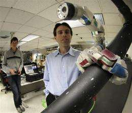 Tool-wielding robots crawl in bodies for surgery (AP)