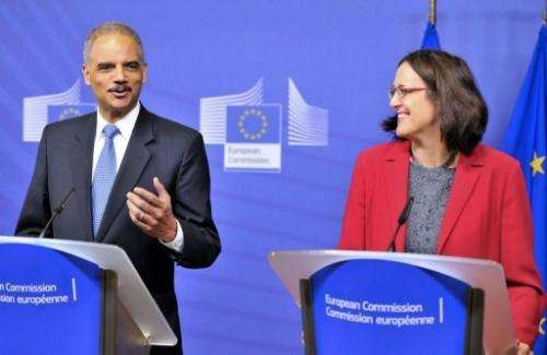 US Attorney General Eric Holder (L) and EU commissioner Cecilia Malmstroem are working to fight child sex online
