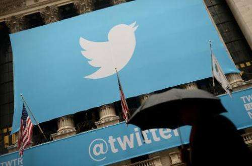 A banner with the Twitter logo is set on the front of the New York Stock Exchange on November 7, 2013 in New York