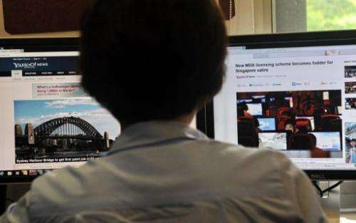 A person browses through media websites on a computer in Singapore on May 30, 2013