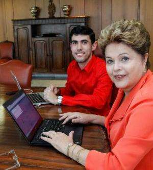 Handout picture released by the presidential press office of Brazilian president Dilma Rousseff (R) navigating on her new webpag
