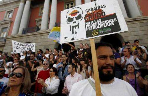 People protest on the Spanish Canary island of Tenerife on March 24, 2012 during a demonstration against plans for petrol firm R