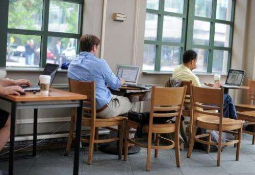People use their laptop computers at a Starbucks in Washington, DC, on May 9, 2012
