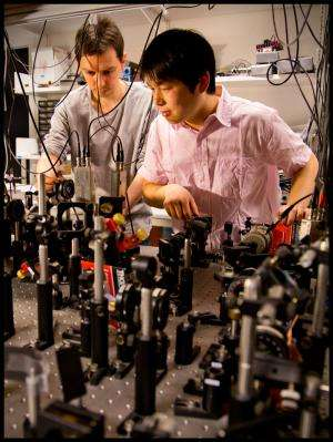 Quantum teleportation between atomic systems over long distances