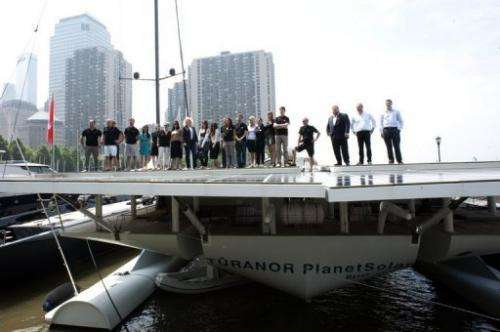 Scientists and crew aboard the world's largest solar boat, Switzerland's MS Turanor PlanetSolar, New York, June 18, 2013