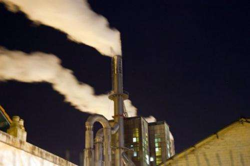 Smoke rises from a paper mill on February 22, 2013 in France