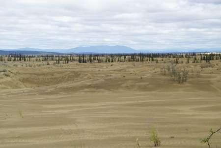 Study finds liquid water flowing above and below frozen Alaskan sand dunes, hints of a wetter Mars