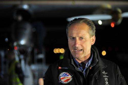 Swiss adventurer Andre Borschberg speaks to reporters as the Solar Impulse prepares for takeoff on May 3, 2013
