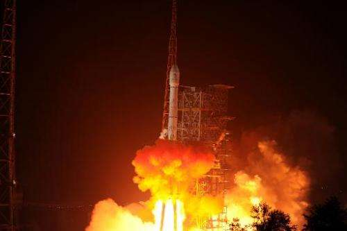 The Chang'e-3 rocket carrying the Jade Rabbit rover blasts off from the Xichang Satellite Launch Center in China's southwest pro